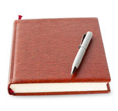 Diary in brown leather cover with silver pen Stock Photos