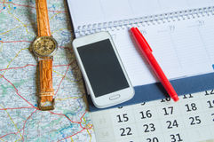 Diary and a calendar with hours, map, travel concept trip copy space Royalty Free Stock Photo