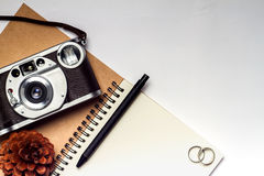 Diary with camera and pencil on white vintage background Stock Images