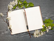 Diary and cherry blossoms Royalty Free Stock Image