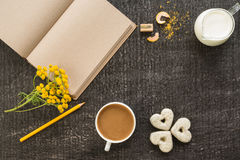 Diary with coffee, flowers and cookies on black Stock Photo