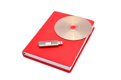 Diary, flash drive and cd. On a white background Stock Photos