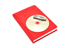 Diary, flash drive and cd. On a white background Royalty Free Stock Images