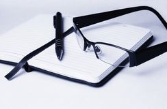 Diary and glasses Stock Image