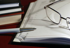 Diary and glasses. Books, pen, glasses and diary Royalty Free Stock Photos