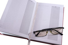 Diary and glasses Stock Photography