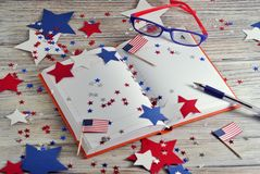 Diary with glasses open on the date of July 4, happy independence day, patriotism and memory of veterans royalty free stock image