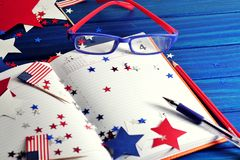 Diary with glasses open on the date of July 4, happy independence day, patriotism and memory of veterans royalty free stock photos
