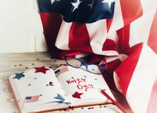 Diary with glasses open on the date of July 4, happy independence day, patriotism and memory of veterans royalty free stock photo
