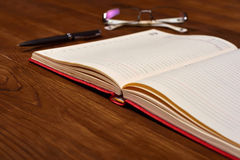 Diary, glasses and pen Royalty Free Stock Photos