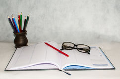 Diary, glasses and a pencil Royalty Free Stock Image