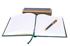 Diary and gold pen Stock Images