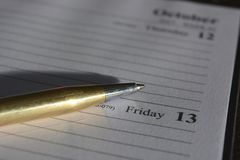 Desk diary open to the date Friday 13 stock photos