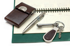 Diary, handle and keys. Diary, the handle and keys on a white background Royalty Free Stock Photo