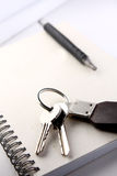 Diary, the handle and keys on a white background Royalty Free Stock Images