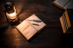 Diary and lamp Royalty Free Stock Photography