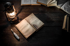 Diary and lamp Royalty Free Stock Images