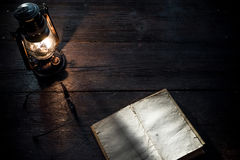 Diary and lamp Stock Images