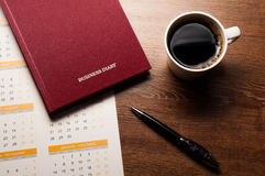 Diary with large pen on the oak desk Stock Photography