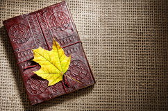 Diary and maple leaf Royalty Free Stock Image