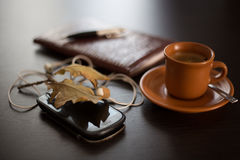Diary, mobile phone and coffee Royalty Free Stock Images