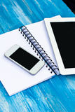 Diary, mobile phone, tablet PC. On the table Royalty Free Stock Images