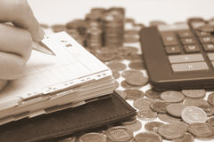 Diary and money. Business concept - diary, coins and calculator Stock Images