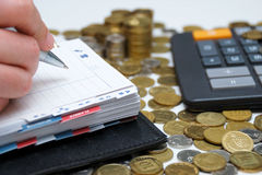 Diary and money. Diary, money and calculator - business concept Royalty Free Stock Photos