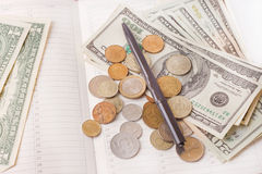 Diary with money and pen isolated Stock Image