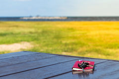 Diary,note book papers and key on wooden at beach background Stock Photography