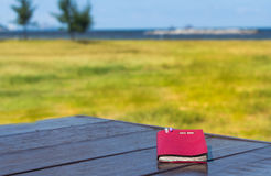 Diary,note book papers on wooden at beach background Stock Photos