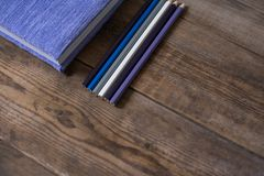 Diary notebook and pencil on the wooden table royalty free stock image