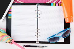 Diary notebook Straw hat tablet and beach accessories on white background Royalty Free Stock Photography