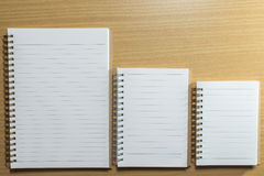 Diary and notebook on wooden table. Top view Royalty Free Stock Images