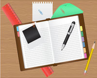 Diary and office supplies. On a wooden table Stock Photography