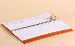 The diary is open on the February page. Pink rose lies on the date of the Valentine`s Day calendar. stock image