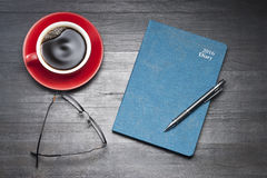Diary Organiser Calendar. A 2016 personal organiser with coffee cup, glasses and pen Royalty Free Stock Photography