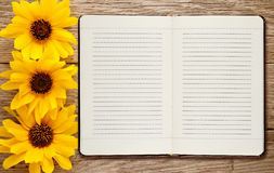 Diary and ornamental sunflowers Royalty Free Stock Photography