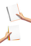 Diary and paper in hand. Stock Photography