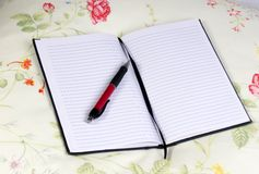 Diary and Pen 4. A leather diary lays open on top of a pillow. Ready for today entry Royalty Free Stock Images