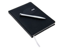 Diary with a pen. Picture of a black diary with silver pen on top isolated Stock Photography