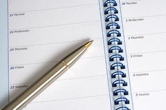 Diary and Pen. Pen resting on an open diary showing the days of the week and the start of a new month Royalty Free Stock Photos