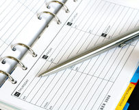 Diary and Pen. Business Diary Organiser and Pen Royalty Free Stock Photography