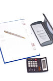 Diary pen and calculator. Business diary with gold pen and black calculator Stock Photography