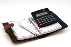 Diary pen and calculator Royalty Free Stock Images
