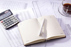 Diary with a pen and calculator. Diary with a pen, calculator and budget text Royalty Free Stock Photography