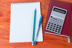 Diary with a pen and a calculator lying on it. Lying on the table a  diary, pen and calculator. Business accessories Royalty Free Stock Image