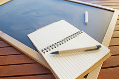Diary, pen and chalk Royalty Free Stock Images