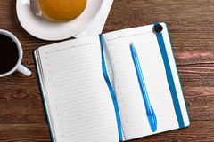 Diary with a pen and coffee royalty free stock images