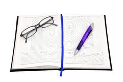 Diary, pen and glasses Stock Photography
